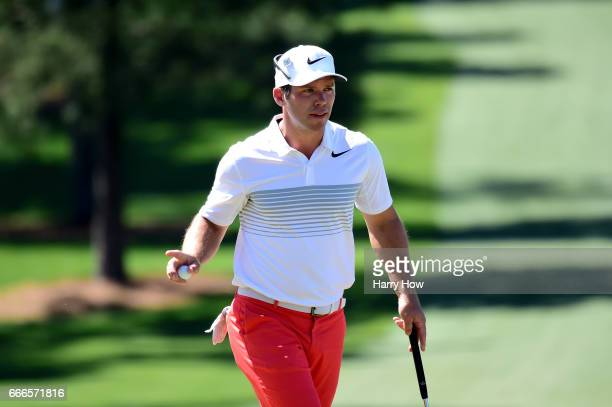 Paul Casey of England waves after saving par on the seventh hole during the final round of the 2017 Masters Tournament at Augusta National Golf Club...