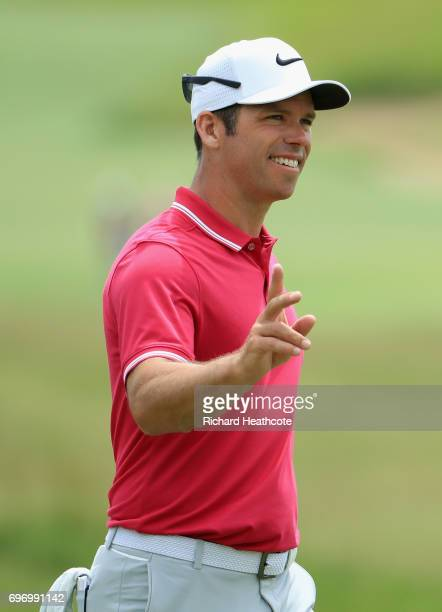 Paul Casey of England waves to the crowd before playing his shot from the first tee during the third round of the 2017 US Open at Erin Hills on June...