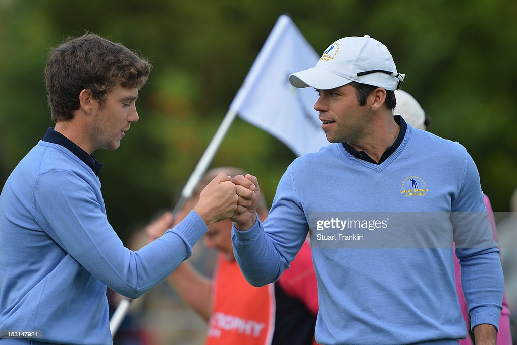 <a gi-track='captionPersonalityLinkClicked' href=/galleries/search?phrase=Paul+Casey&family=editorial&specificpeople=198895 ng-click='$event.stopPropagation()'>Paul Casey</a> of the Great Britain and Ireland team celebrates with palying partner <a gi-track='captionPersonalityLinkClicked' href=/galleries/search?phrase=Tommy+Fleetwood&family=editorial&specificpeople=4450351 ng-click='$event.stopPropagation()'>Tommy Fleetwood</a> during the third day's morning foursomes at the Seve Trophy at Golf de Saint-Nom-la-Breteche on October 5, 2013 in Paris, France.