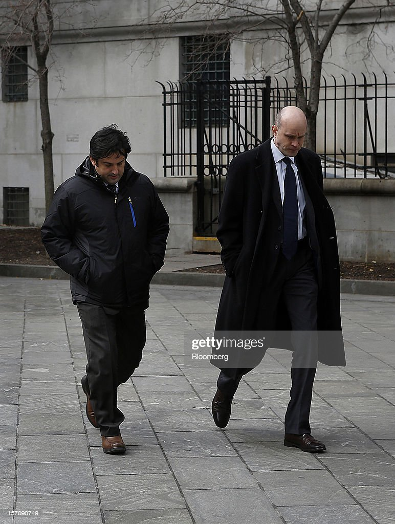 Paul Ceglia, indicted on charges of mail fraud and wire fraud, left, arrives with his attorney, Dean Boland, at federal court in New York, U.S., on Wednesday, Nov. 28, 2012. Ceglia, 39, pleaded not guilty to criminal charges that he faked evidence in his contract lawsuit against Facebook Inc. and its chief executive officer, Mark Zuckerberg. Photographer: Victor J. Blue/Bloomberg via Getty Images