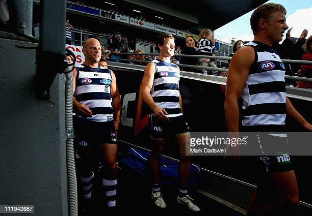 Paul Chapman and Cameron Mooney of the Cats walk out of the players race for the round three AFL match between the Geelong Cats and the Port Adelaide...