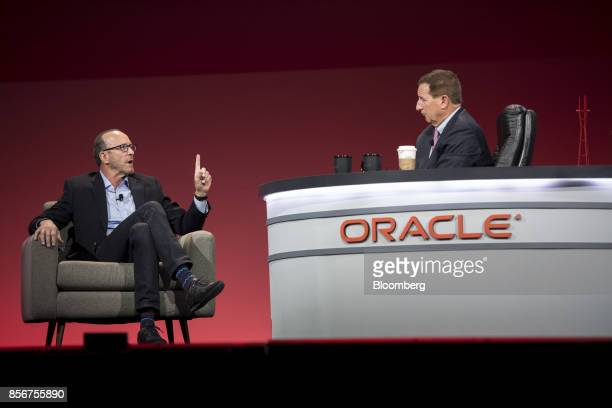 Paul Chapman executive vice president and chief investment officer of Gap Inc left speaks as Mark Hurd chief executive officer of Oracle Corp listens...