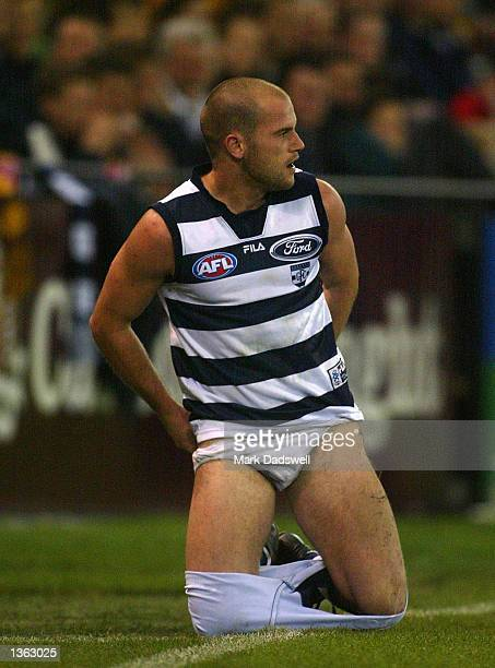 Paul Chapman for the Cats losses his shorts in a tackle during the round 22 AFL match between the Geelong Cats and the Hawthorn Hawks played at the...