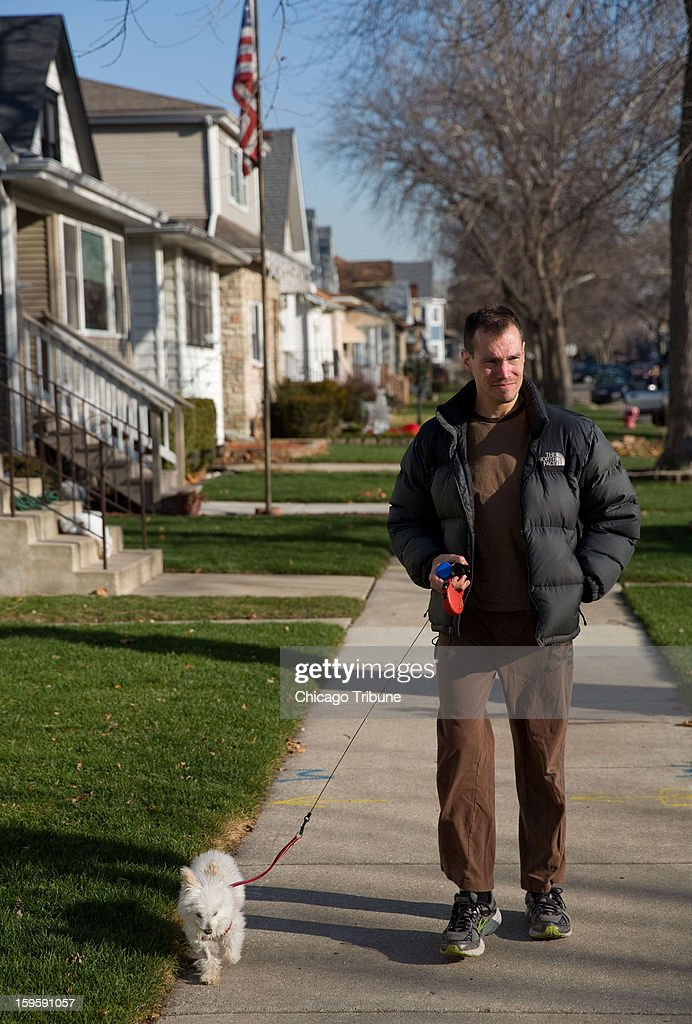 Paul Christiano leaves a friend's apartment in Chicago, Illinois, to walk the dog on December 14, 2012. Christiano, convicted for buying child pornography, is a pedophile who says he has never molested any children. He says he is attracted to young girls. Once a celebrated ballet dancer, he now walks dogs for money.