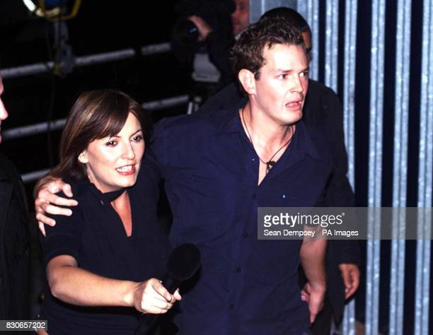 Paul Clarke with hostess Davina McCall leaving the Channel Four Big Brother house in Bow east London after being evicted Clarke became the seventh...