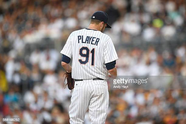Paul Clemens of the San Diego Padres wears a temporary jersey with Player after getting pine tar on his uniform while pitching during the game...