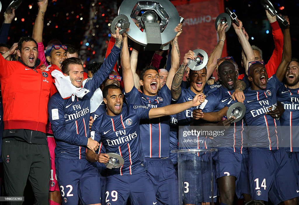 Paul Clement, David Beckham, Lucas Moura, captain Thiago Silva, Gregory Van Der Wiel, Mamadou Sakho, Blaise Matuidi, Jeremy Menez celebrate PSG's french championship title 2013 during the trophy ceremony after the Ligue 1 match between Paris Saint-Germain FC and Stade Brestois 29 at the Parc des Princes stadium on May 18, 2013 in Paris, France.