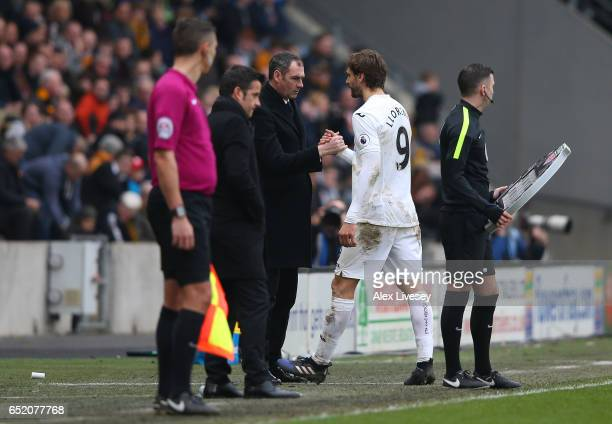 Paul Clement Manager of Swansea City and Fernando Llorente of Swansea City embrace during the Premier League match between Hull City and Swansea City...