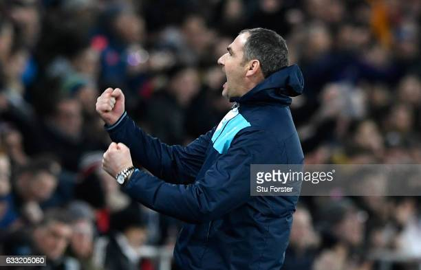 Paul Clement Manager of Swansea City celebrates his side's 21 victory at the final whistle in the Premier League match between Swansea City and...