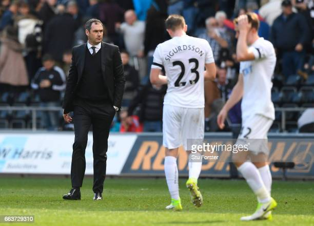 Paul Clement Manager of Swansea City walks onto the pitch to speak to his players after the Premier League match between Swansea City and...