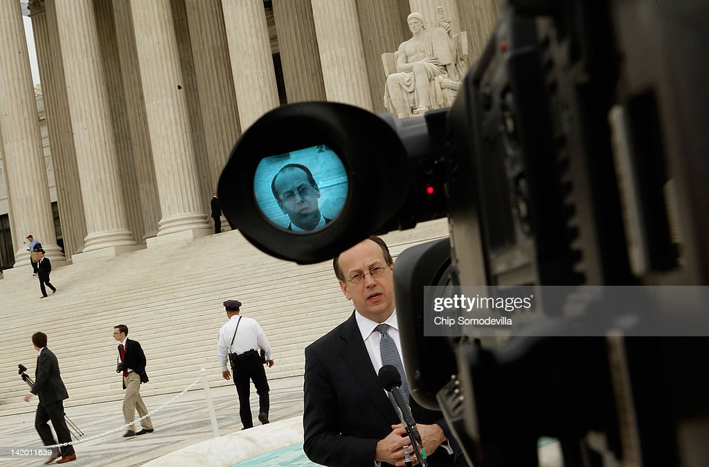 Paul Clement, the attorney representing the 26 states challenging the Patient Protection and Affordable Care Act, talks to the news media outside the U.S. Supreme Court on the third day of oral arguements over the constitutionality of the act March 28, 2012 in Washington, DC. Wednesday was the last of three days the high court set to hear arguments over the act.