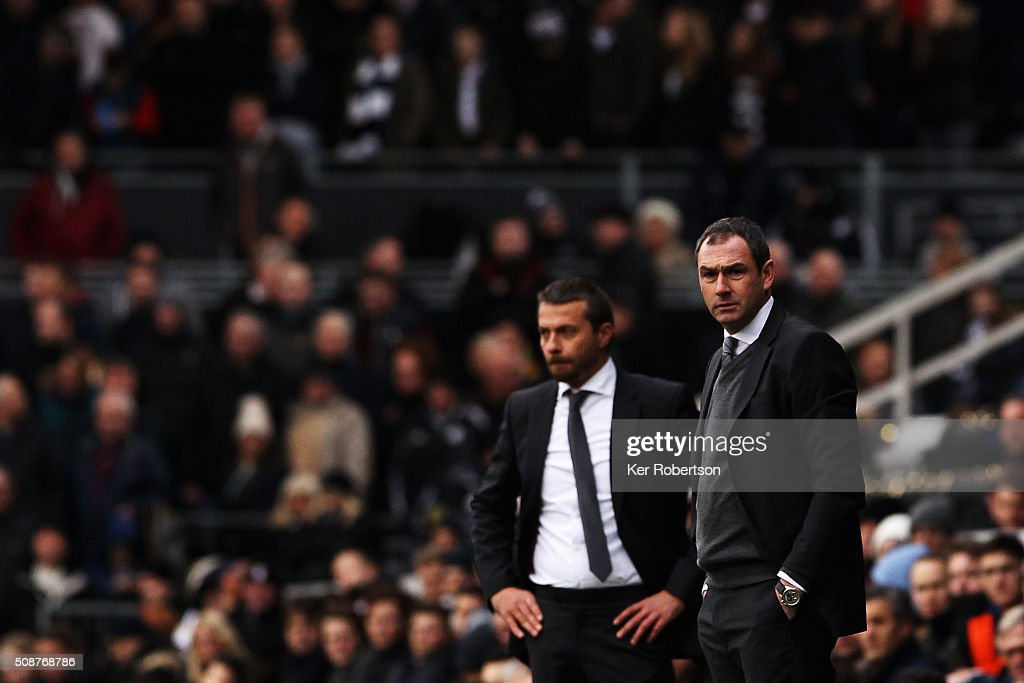 Paul Clement (R) the Derby County Head Coach looks on before the Sky Bet Championship match between Fulham and Derby County at Craven Cottage on February 6, 2016 in London, England.