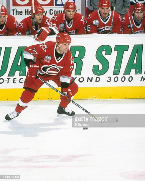 Paul Coffey of the Carolina Hurricanes skates with the puck during an NHL game in December 1999