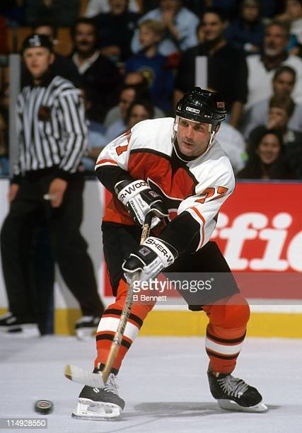 Paul Coffey of the Philadelphia Flyers passes the puck during an NHL game against the New Jersey Devils on October 8 1997 at the Continental Airlines...