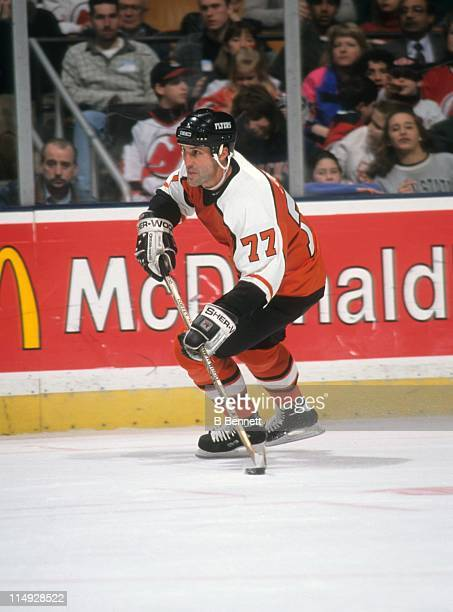 Paul Coffey of the Philadelphia Flyers skates with the puck during an NHL game against the New Jersey Devils on March 2 1998 at the Continental...