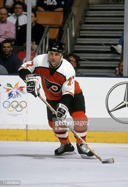 Paul Coffey of the Philadelphia Flyers skates with the puck during an NHL game against the New Jersey Devils circa 1998 at the Continental Airlines...