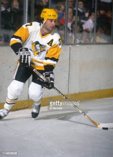 Paul Coffey of the Pittsburgh Penguins skates with the puck during an NHL game in March 1988 at the Mellon Arena in Pittsburgh Pennsylvania