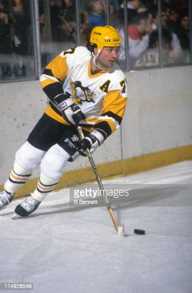 Paul Coffey of the Pittsburgh Penguins skates with the puck during an NHL game circa 1988 at the Mellon Arena in Pittsburgh Pennsylvania