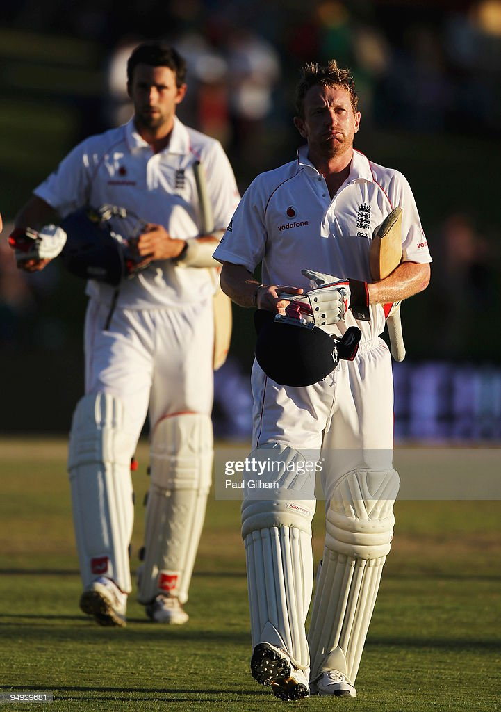 Paul Colliingwood and Graham Onions of England walk off following England's draw with South Africa during day five of the first test match between...