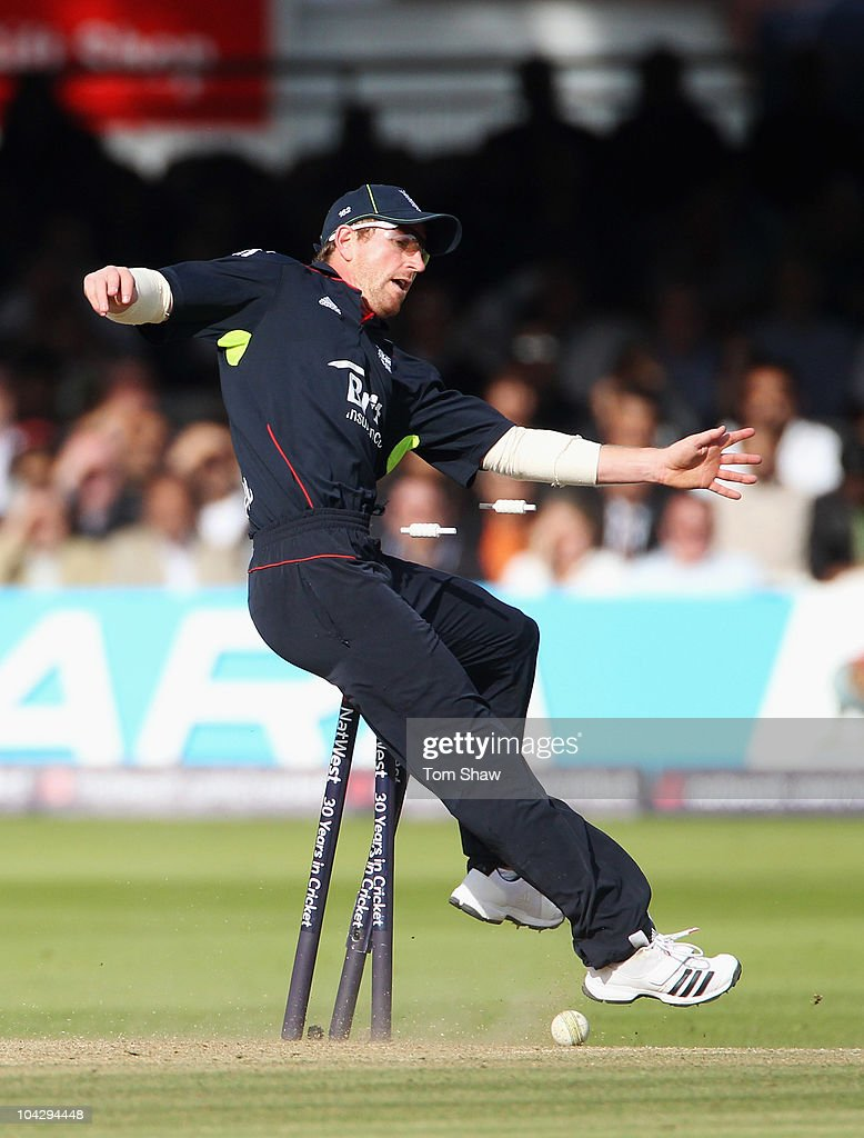 <a gi-track='captionPersonalityLinkClicked' href=/galleries/search?phrase=Paul+Collingwood&family=editorial&specificpeople=204191 ng-click='$event.stopPropagation()'>Paul Collingwood</a> of England crashes into the stumps as he attempts to run out Shahid Afridi of Pakistan during the 4th NatWest One Day International between England and Pakistan at Lord's on September 20, 2010 in London, England.