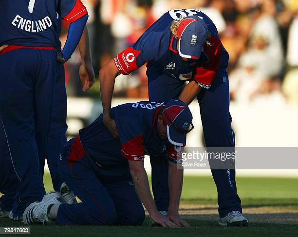 Paul Collingwood of England is helped to his feet by Stuart Broad after attempting a run out off the last ball of the fourth National Bank series One...