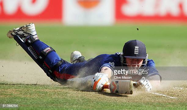 Paul Collingwood of England makes his ground on his way to 80 runs not out during the reserve day of the ICC Champions Trophy match between England...