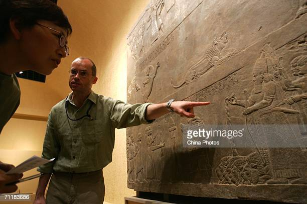 Paul Collins of British Museum displays an article from ancient Assyria at the Shanghai Museum on June 12 2006 in Shanghai China The British Museum...