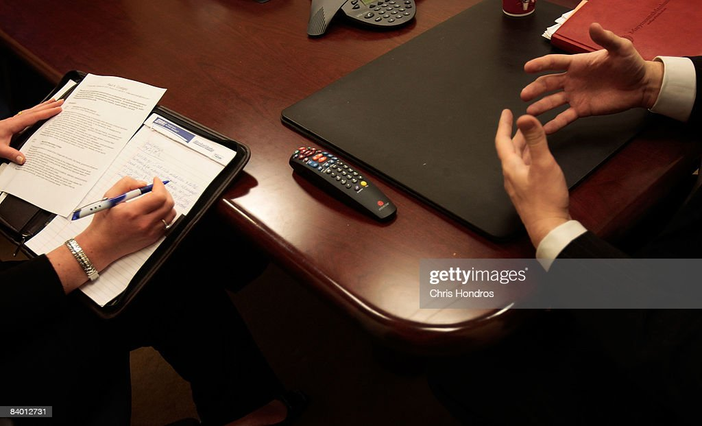 Paul Costiglio a marketing and public relations professional talks while recruiter Julie Jarrett of the executive search firm Heyman Associates takes...