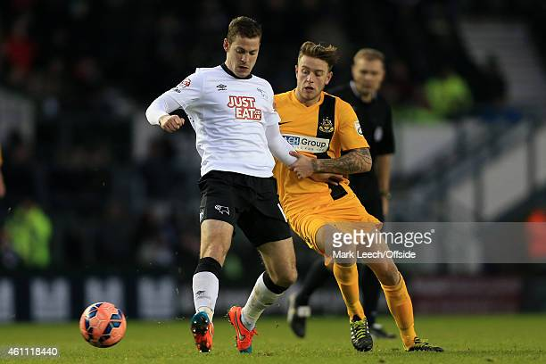 Paul Coutts of Derby battles with Charlie Joyce of Southport during the FA Cup Third Round match between Derby County and Southport FC at the iPro...