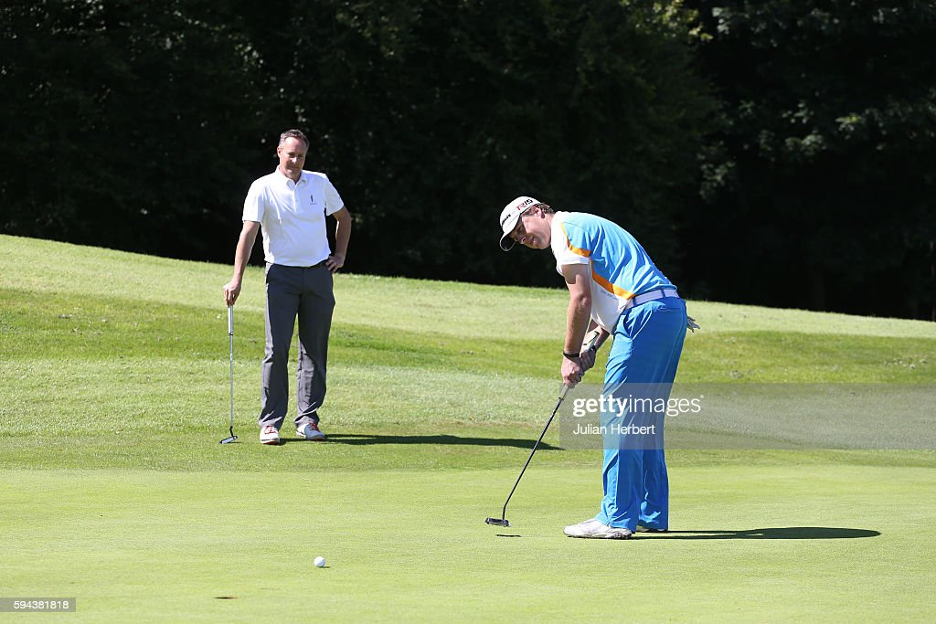 Paul Creamer of Foxhills Club and Resort looks on as his team mate Paul Hadfield putts during The PGA ProCaptain South West Qualifier at Bowood Golf...