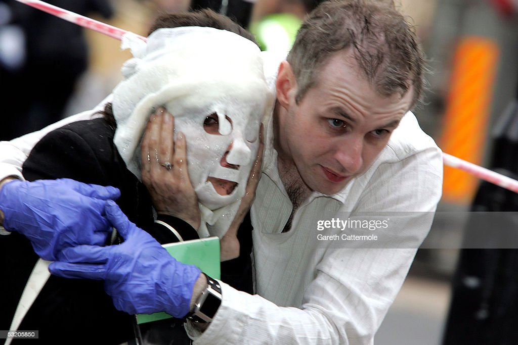 Paul Dadge (R), 28, helps Davinia Turrell, 24, to safety at Edgware Road station following a series of explosions which ripped through London's underground tube network on July 7, 2005 in London, England. Blasts have been reported on the underground network and buses across the capital.