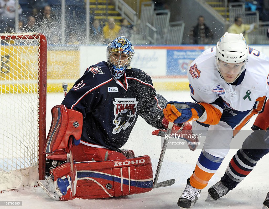 Paul Dainton #31 of the Springfield Falcons is sprayed with snow as he tends goal during an American Hockey League game against the Bridgeport Sound Tigers on January 20, 2013 at the Webster Bank Arena at Harbor Yard in Bridgeport, Connecticut.