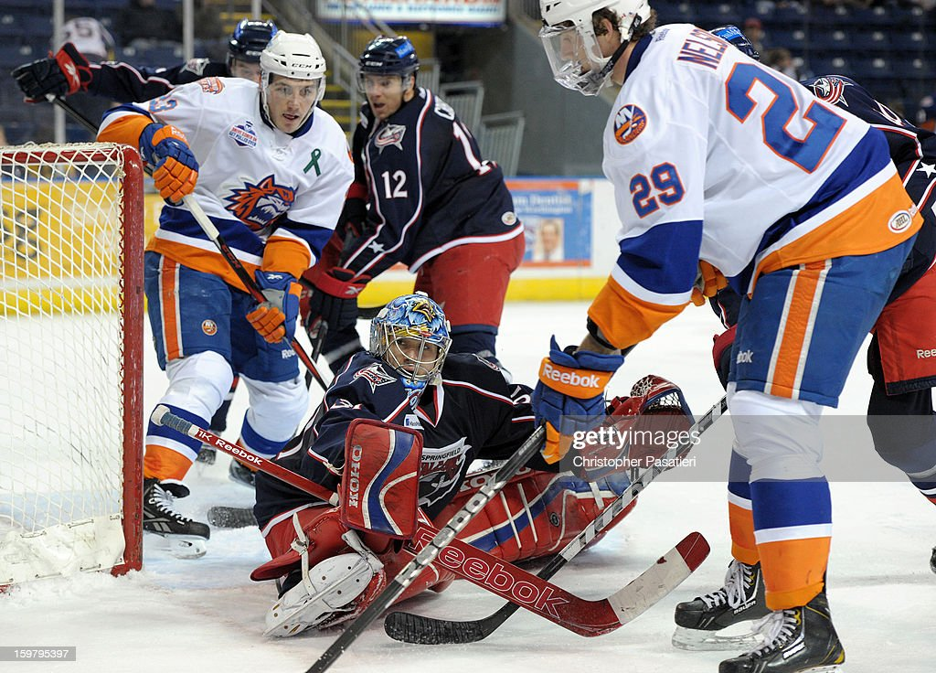 Paul Dainton #31 of the Springfield Falcons looks back at the referee after making a save during an American Hockey League game against the Bridgeport Sound Tigers on January 20, 2013 at the Webster Bank Arena at Harbor Yard in Bridgeport, Connecticut.
