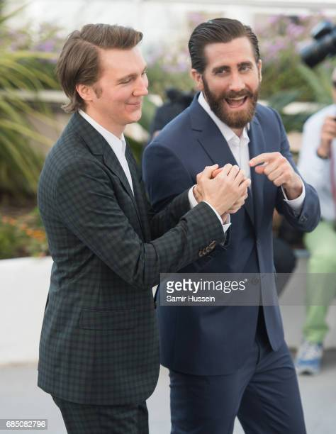 Paul Dano and Jake Gyllenhaal attend the 'Okja' photocall during the 70th annual Cannes Film Festival at Palais des Festivals on May 19 2017 in...