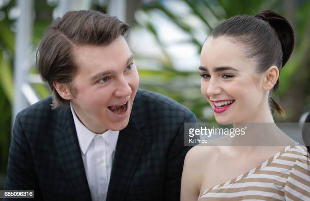 Paul Dano and Lily Collins attend the 'Okja' photocall during the 70th annual Cannes Film Festival at Palais des Festivals on May 19 2017 in Cannes...