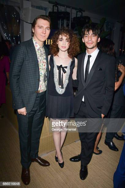 Paul Dano Lily Collins and Devon Bostick attend the Hollywood Foreign Press Association's 2017 Cannes Film Festival Event in honour of the...