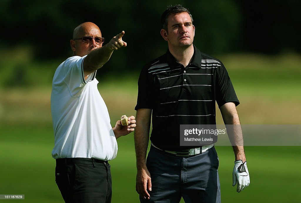 Paul Davies and Andrew Rhodes of Keighley Golf Club look on during the Lombard Challenge Regional Qualifier at Huddersfield Golf Club on September 3, 2012 in Huddersfield, England.