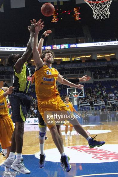 Paul Davis of BC Khimki Moscow competes with Romain Sato of Fenerbahce Ulker during the 20122013 Turkish Airlines Euroleague Top 16 Date 5 between...