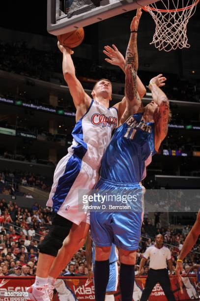 Paul Davis of the Los Angeles Clippers puts up a shot against Chris Andersen of the Denver Nuggets at Staples Center on October 31 2008 in Los...