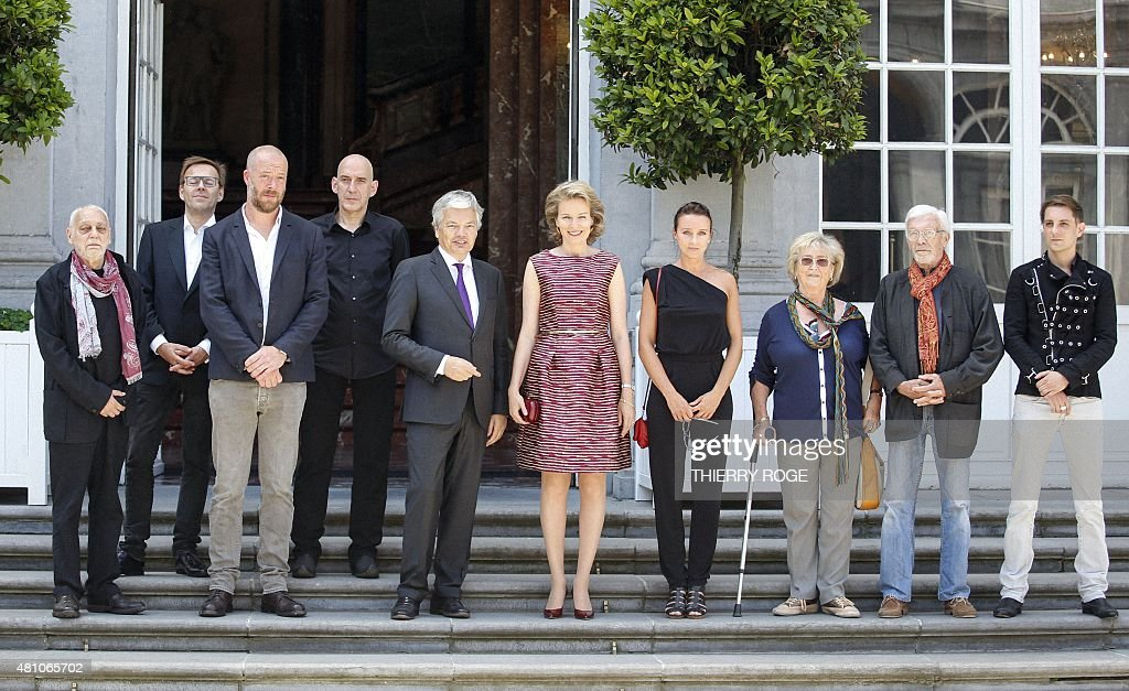 Paul De Vylder, Wim Delvoye, Stephane Halleux, Johan Muyle, MR Vice-Prime Minister and Foreign Minister Didier Reynders, Queen Mathilde of Belgium, Nadia Naveau, unidentified woman and man and Michael Aerts pose during the inauguration of the exhibition '@yourservice', organized by the Belgian Foreign Affairs at the Egmont Palace in Brussels on the occasion of the National Day on July 17, 2015.