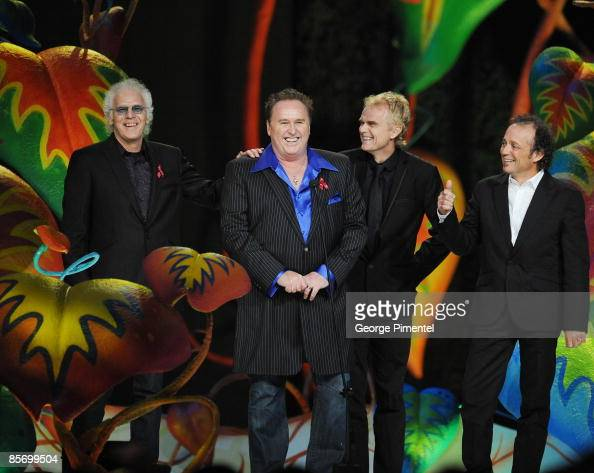 Paul Dean Mike Reno Doug Johnson and Matt Frenette of Loverboy accept the Juno Award as they are inducted into the Canadian Music Hall of Fame on...