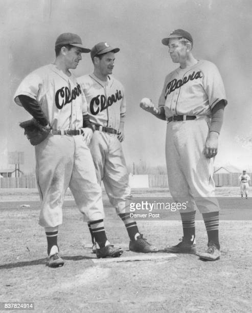 Paul Dean onetime major league great shows two ***** Pioneer pitchers Joe Borrego of San Francisco and Clarence Black of Marks Miss his famous grip...