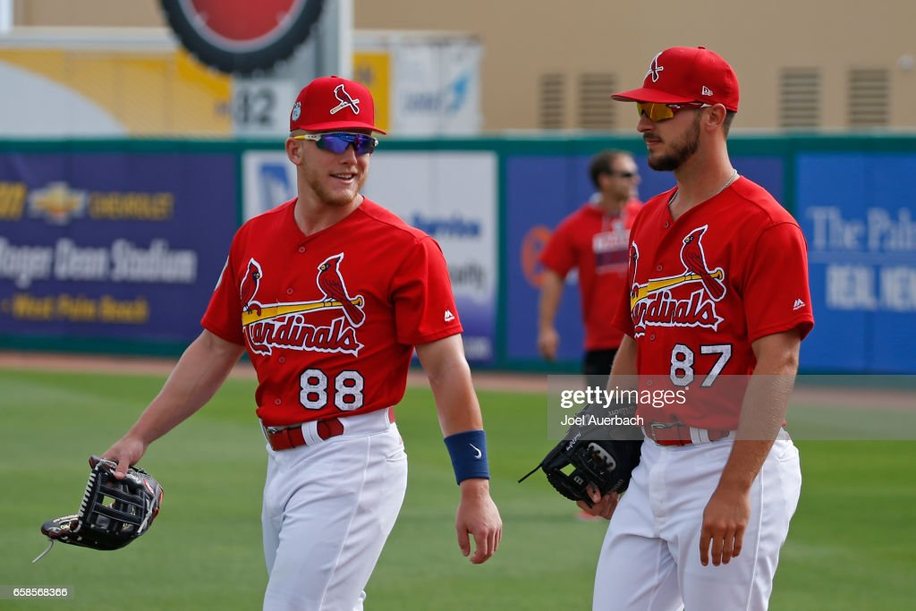 Paul DeJong #87 and Harrison Bader #88 of the St Louis Cardinals enter the field for the spring training game against the Miami Marlins at Roger Dean Stadium on March 26, 2017 in Jupiter, Florida. The Cardinals defeated the Marlins 3-0.
