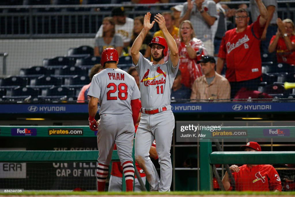 Paul DeJong #11 of the St. Louis Cardinals celebrates afar scoring on a two RBI triple in the seventh inning against the Pittsburgh Pirates at PNC Park on August 17, 2017 in Pittsburgh, Pennsylvania.
