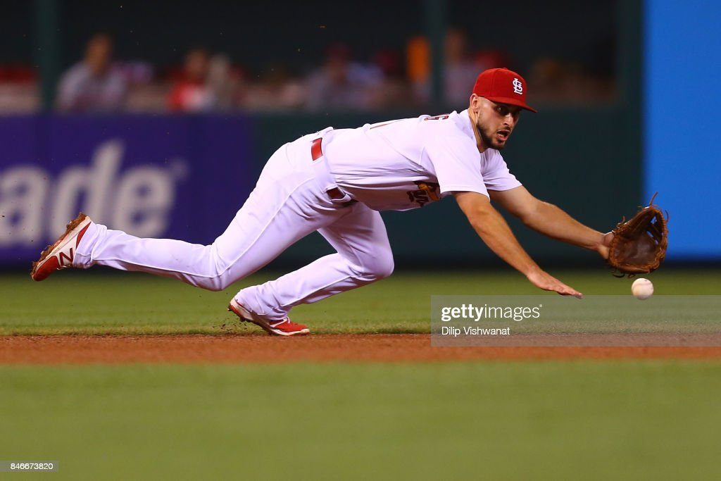 Paul DeJong #11 of the St. Louis Cardinals fields a ground ball against the Cincinnati Reds in the fifth inning at Busch Stadium on September 13, 2017 in St. Louis, Missouri.