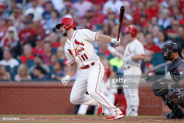 Paul DeJong of the St Louis Cardinals follows through on a RBI single during the first inning against the Arizona Diamondbacks at Busch Stadium on...