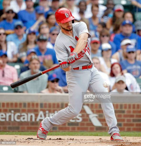 Paul DeJong of the St Louis Cardinals hits a single against the Chicago Cubs during the first inning at Wrigley Field on September 17 2017 in Chicago...