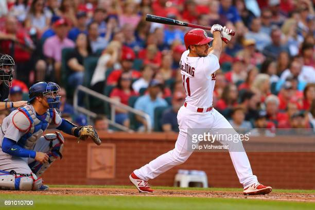 Paul DeJong of the St Louis Cardinals hits an RBI double against the Los Angeles Dodgers in the second inning at Busch Stadium on May 31 2017 in St...
