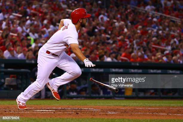Paul DeJong of the St Louis Cardinals hits an RBI double against the Atlanta Braves in the second inning at Busch Stadium on August 11 2017 in St...