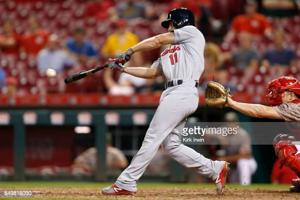 Paul DeJong of the St Louis Cardinals hits an RBI single during the tenth inning of the game against the Cincinnati Reds at Great American Ball Park...